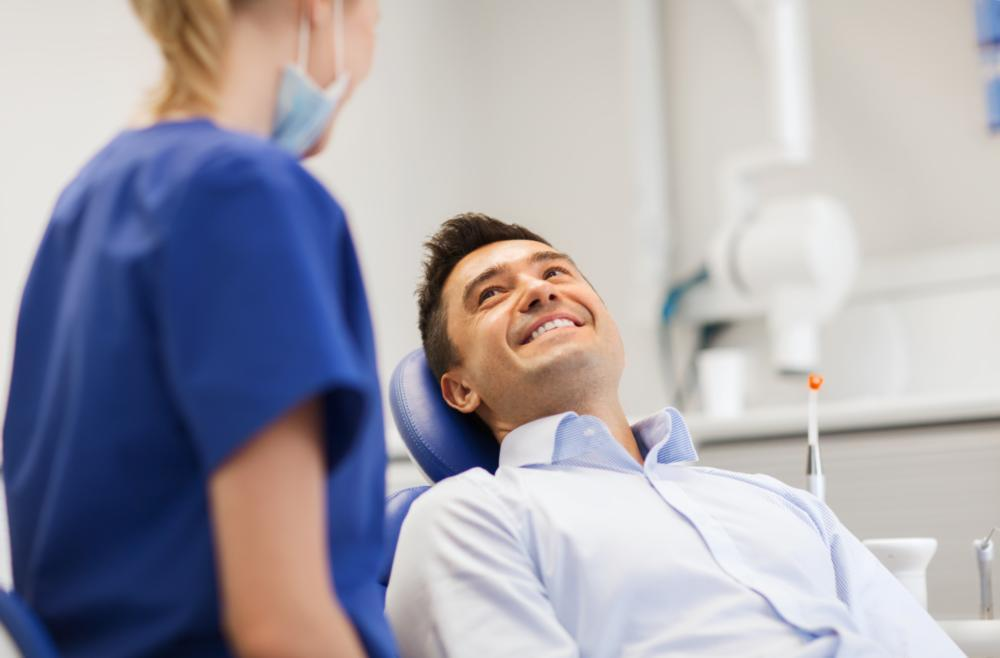 Man smiling in dental chair | Dentist Edina MN