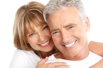 a man and a woman smile together | Edina MN dental crowns