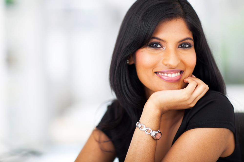 Woman smiling in office | Dentist Edina MN