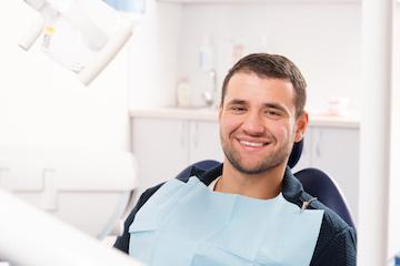 A man smiles in the dental chair | Edina Periodontal Care