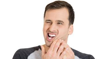 A man holding his jaw | Edina MN Dentist
