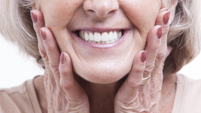A close up of an older woman's smile | cosmetic dentist edina