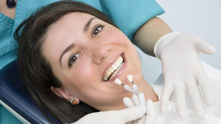 Having her teeth professionally whitened | 50th & France Dental Care