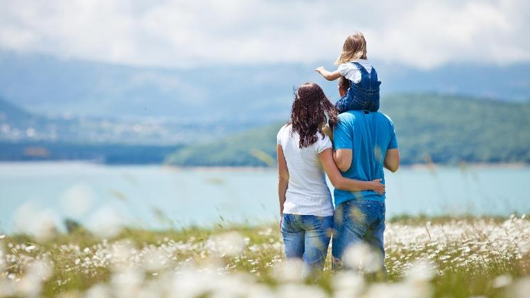 Picture of a family overlooking a lake