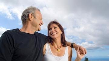 A man and his wife smile at each-other | Edina, MN dental implants